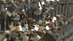 Locks are hanging on fence. Symbols of love and dedication.  Stock Footage