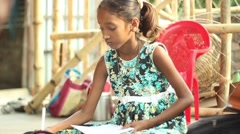 Girl studying in a village school in Bengal, India still medium shot Stock Footage