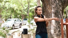 Eurasian woman stretching her arms and shoulder for warm up Stock Footage