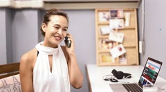 Eurasian woman informally conversing on the phone Stock Footage