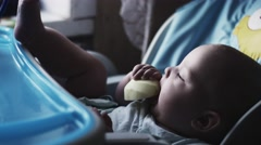 Adorable cute baby sitting at children table eating pear. Feeding. Fruits. Care Stock Footage