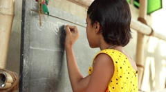 Young girl student in Bengal, India, writes in Bengali on a chalkboard Stock Footage