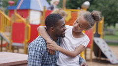 4K Portrait smiling father & daughter at outdoor adventure playground Stock Footage