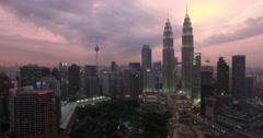 4k Aerial side sweep shot of the Kuala Lumpur skyline petronas towers purple sky Stock Footage