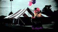 Clown carnival laughing at camera with balloons Stock Footage