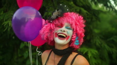 Clown laugh outside by tree Stock Footage