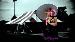 Clown with umbrella amusement park Stock Footage