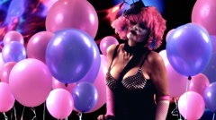 clown woman dance with lights balloons - stock footage