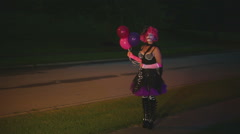 clown woman outside at night summer - stock footage