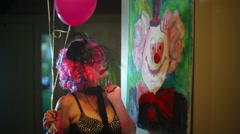 clown woman look at painting clown - stock footage