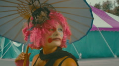 Clown woman unbrella colorful Stock Footage
