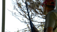 Shooter man aiming and firing a rifle in skeet Stock Footage