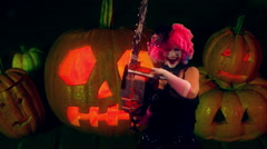 Halloween clown with chainsaw woman Stock Footage