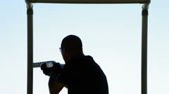 Silhouette of a shooter skeet shooting in a sports competition Stock Footage
