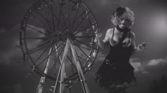 Old timey clown and ferris wheel Stock Footage