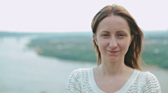 Woman looking at camera and making funny face Stock Footage