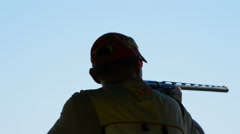 Silhouette of a shooter skeet shooting Stock Footage