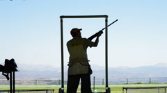 Silhouette of a shooter skeet shooting in a championship Stock Footage