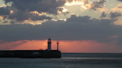 Sunrise in Yalta against a beacon, a view from central embankment Stock Footage