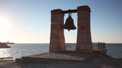 Alarm ancient bell on the bank of the Black Sea, Chersonese, Sevastorpol Stock Footage