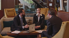 Business Meeting in the Hotel Lobby Area Stock Footage