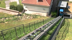 Blue funicular moves uphill. - stock footage