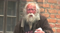 Old homeless man is singing. - stock footage