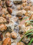 flowing water and stones - stock photo