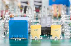 Closeup electronic hardware on the circuit board Stock Photos