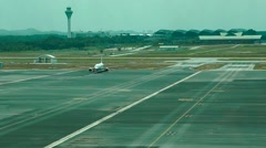 Plane sitting on tarmac of KLIA2 airport - stock footage
