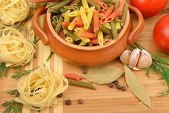 Macaroni, noodles and spices Stock Photos