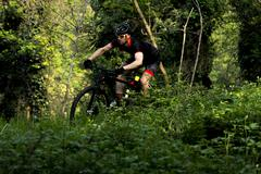 Man riding mountain bike in nature in the Bologna countryside, Italy - stock photo