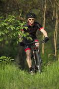 Man riding mountain bike in nature in the Bologna countryside, Italy Stock Photos