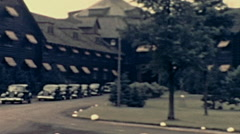 Canada 1938: cars parked outside Chateaux Montebello Stock Footage