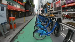 NEW YORK CITY –Bicycles are shown docked at a Citibike sharing kiosk - stock footage