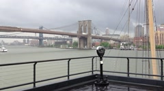 Brooklyn Bridge from Pier  on a rainy day Stock Footage