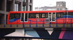 LONDON – Overground train in Canary Wharf, London. Overground Stock Footage