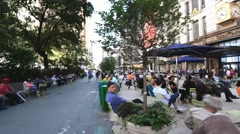NEW YORK CITY – People walk on a city square. New York attracts 50 Stock Footage