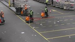 Staff travels with empty cart of flowers at Aalsmeer FloraHolland Auction Market - stock footage