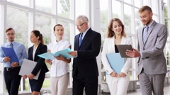 Business people walking along office building 10 Stock Footage
