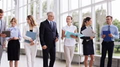 Business people walking along office building 15 Stock Footage