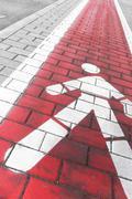 Red pedestrians lane along a sidewalk Stock Photos