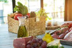 Raw meat and vegetables. Stock Photos