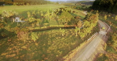 Aerial of car driving on country road in the coromandel, New Zealand Stock Footage