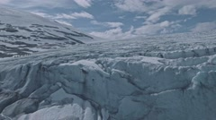 Amazing aerial view on scenic Jostedalsbreen glacier with group of climbers on Stock Footage