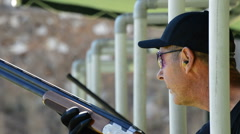 Shooter man aiming and firing in skeet championship Stock Footage