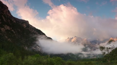 Fog and Clouds over Lake and Mountains. Time Lapse Stock Footage