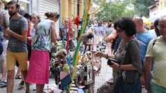 People buying and selling souvenirs on a city street festival Stock Footage