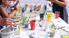 Children art - kids paint draw paintings on a street urban cultural festival Stock Footage