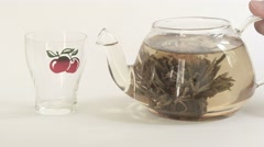 Pour tea from teapot Stock Footage